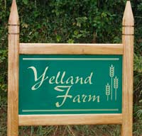 Simple entrance sign with gothic posts tops