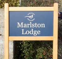 Simple entrance sign with bevelled posts tops