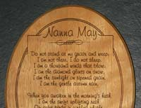 engraved oval wood plaque