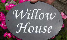 Black granite oval house sign