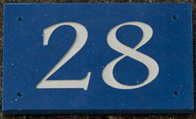 Quartzite door numbers in three bold colours