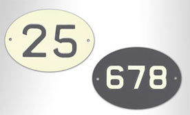 House number signs in the style of vintage number plates