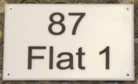 Stone-Like corian is a good option for house numbers - lots of colours