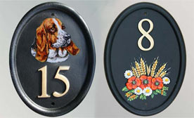Long lasting cast and hand painted house number signs