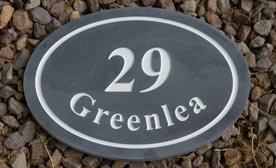 Oval and round slate door number signs