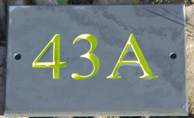 Slate house numbers with lots of fonts and letter colours