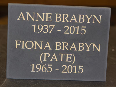 Slate memorial plaque with cream letters