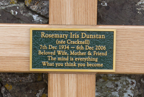 Bronze memorial plaque fixed to an extra large oak cross