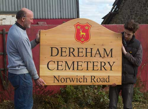 Cemetery sign using red cedar wood with full colour anodised aluminium insert