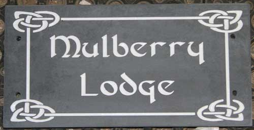 Slate house sign with celtic font and border