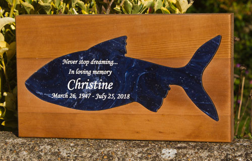 Engraved corian fish inset into red cedar