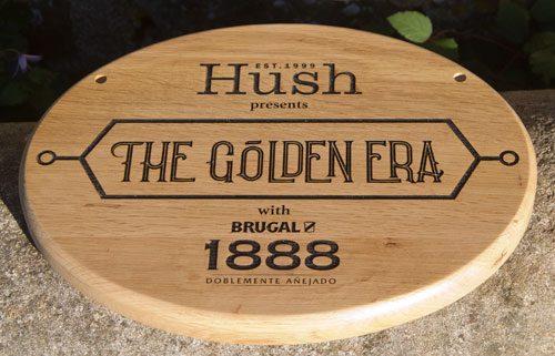 Oval oak sign with detailed text