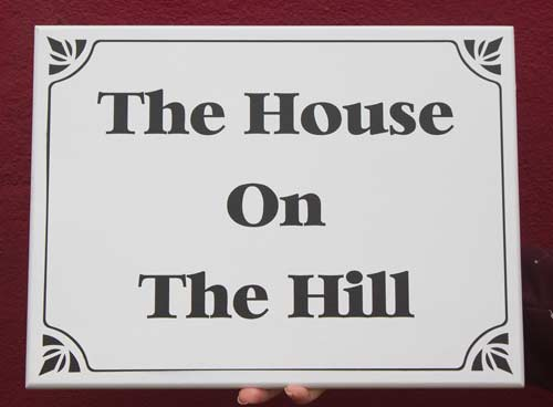 White painted house sign