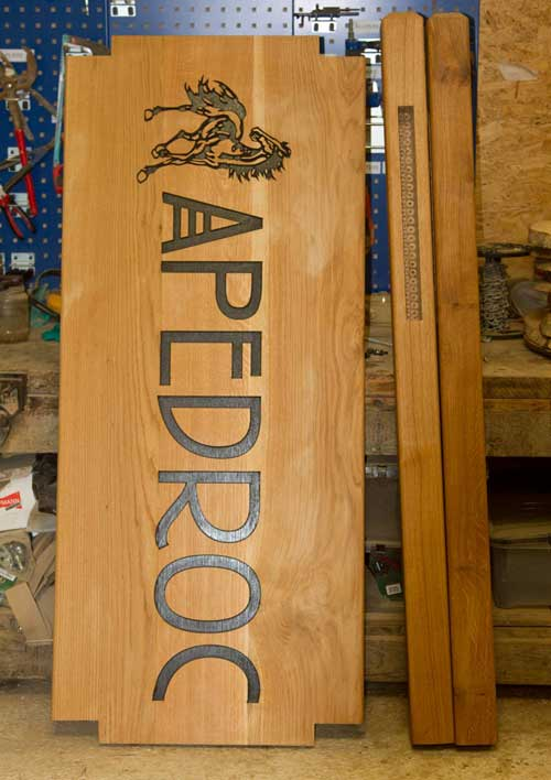 Large oak sign with posts