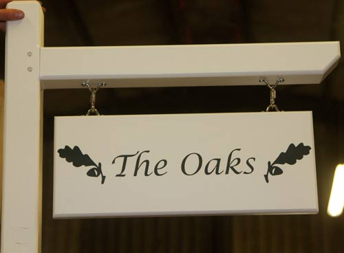 Double sided hanging house sign