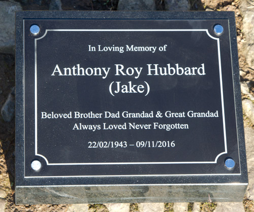 Black aluminium memorial plaque on black granite wedge