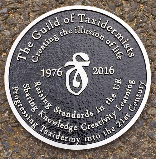 Cast aluminium plaque with a black background
