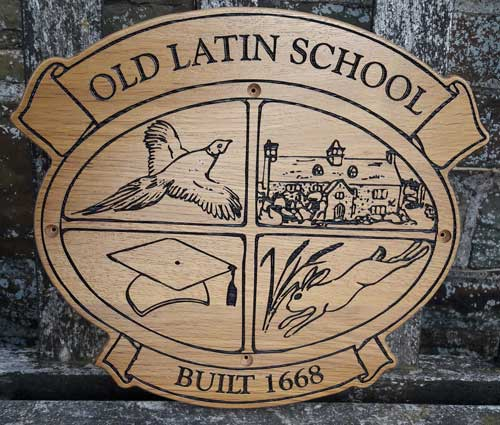 Wooden sign created in the shape of the school crest