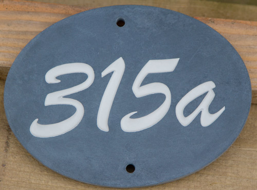 Oval slate house number sign