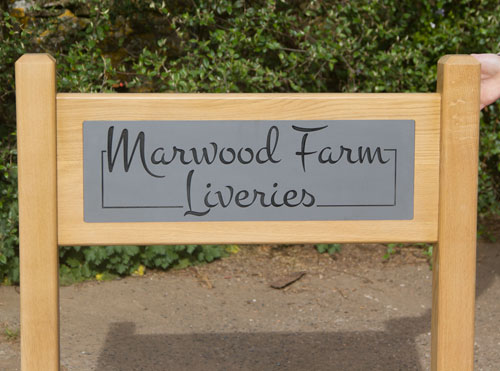 Superior entrance signs using engraved corian and solid oak
