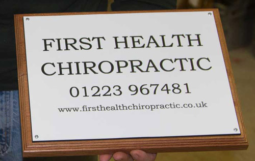 Engraved business plaque made in a white and black acrylic laminate