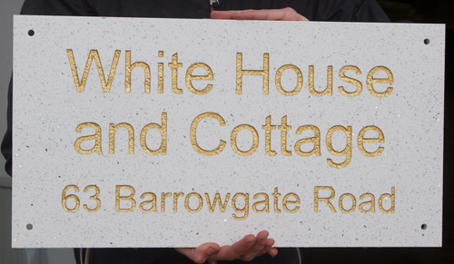 House sign made with white cosmos quartzite