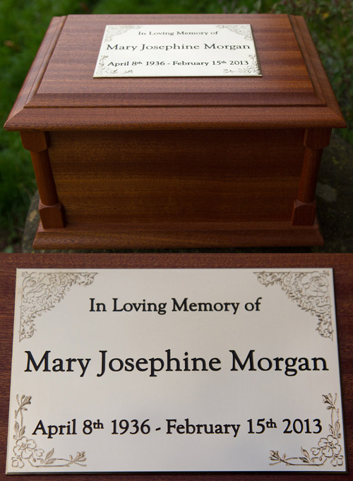 Brass plaque on a mahogany ash casket