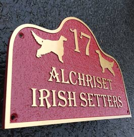 Cast bronze house sign with special background colour