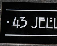 Engraved colured aluminium house sign