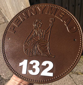 House number sign made to look like old penny