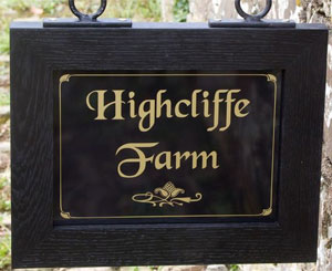 Wood framed hanging sign