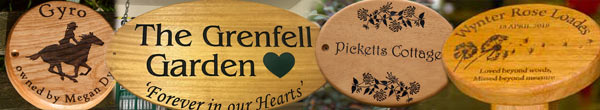 Round and oval wooden signs and memorial plaques.