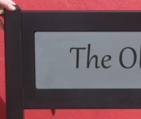 Entrance sign with engraved corian insert