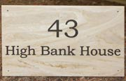 House sign in stone like marble corian