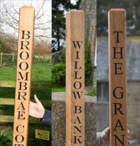 Carved lettering on wooden posts