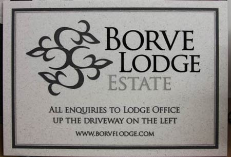 Stone like corian estate sign