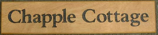 Wooden Sign with Lettering