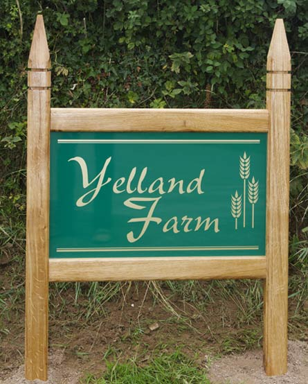 Wooden framed sign with posts