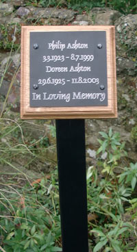Memorial Plaque On Backing Board With Tree Stake