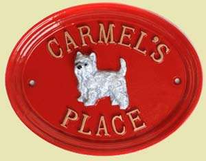 Red cast metal house sign