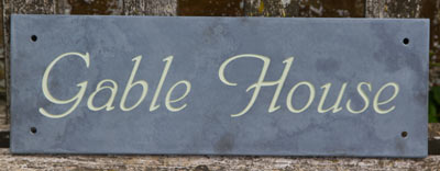 Slate sign with text lichen green