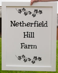 Painted Black and White Wooden Framed Signs
