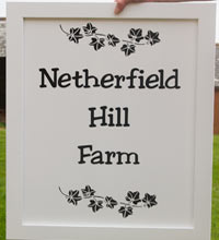 Black and whited painted framed sign
