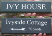 Painted wooden signs in lots of colours