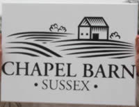 Painted wooden signs in black and white and many other colours