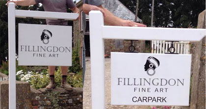 White wooden signs with wrought iron fixings