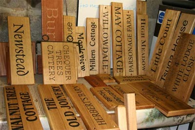 A selection of Wooden House Signs ready for dispatch