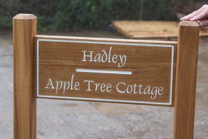 Oak ladder sign with white letters